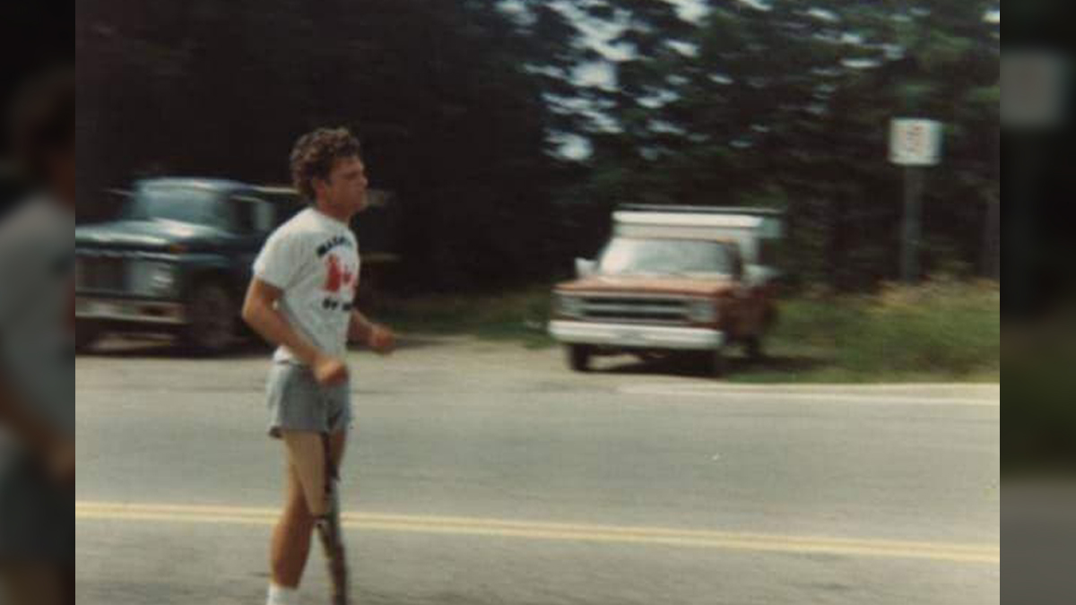A determined Terry Fox grimaces as he runs past The Blue Moon in Petersburg on Sunday, July 20, 1980. Photo Shelley Vollmer.