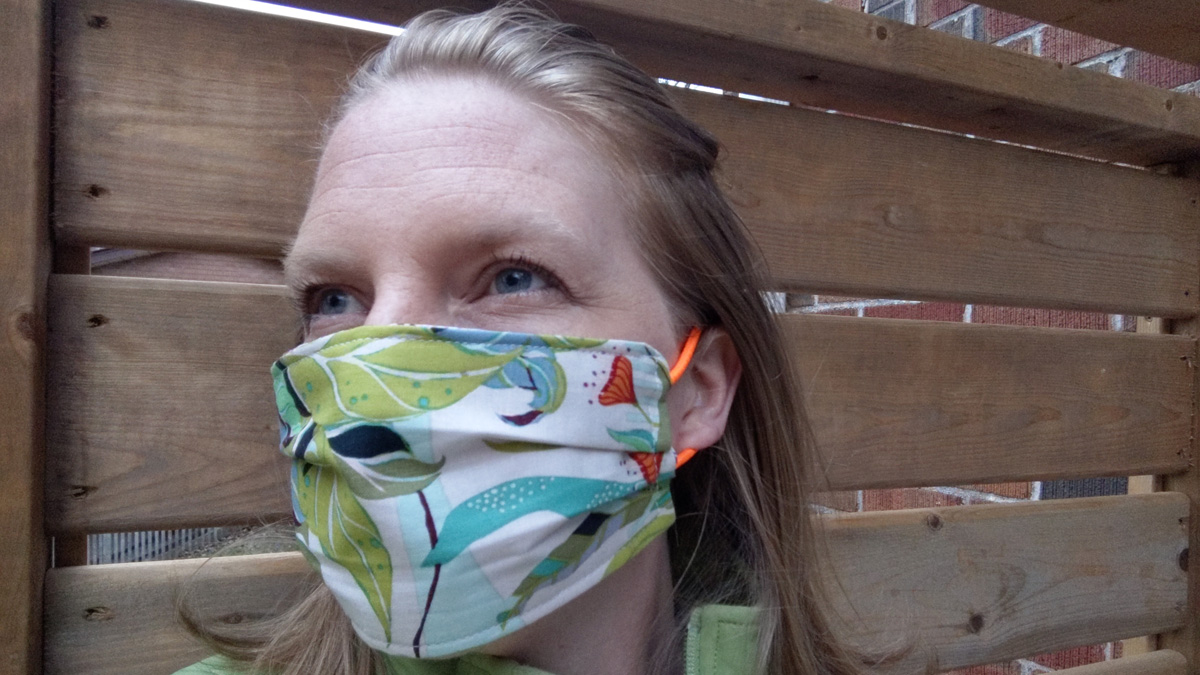 Stephanie Goertz models one of the masks she made, using fabric donated by TCP - Photo Stephanie Goertz