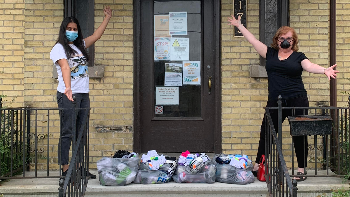 Wilmot Family Resource Centre's Client Care Coordinator Harpreet Dhaliwal and ToastyToes' founder Sharon Gilroy-Dreher with 365 pairs of donated socks. (Photo ToastyToes)